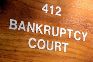 bankruptcy court door 300x200 Voluntary vs. Involuntary Bankruptcy   Liquidation